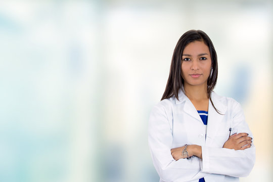 confident doctor medical professional standing in hospital