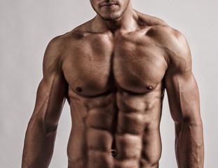 Portrait in studio of muscular man.