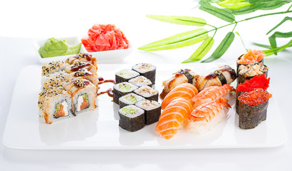 Sushi set on white plate over white background