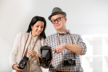 Man and woman hold retro camera
