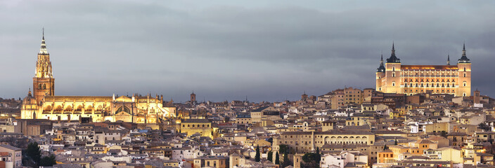 Toledo skyline at sunset with cathedral and alcazar. Spain