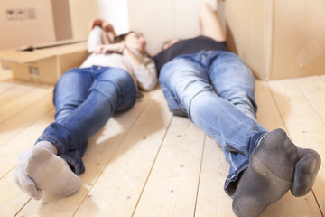 young couple relaxing after moving