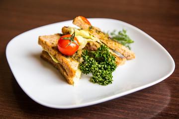 breakfast sandwich on wooden background