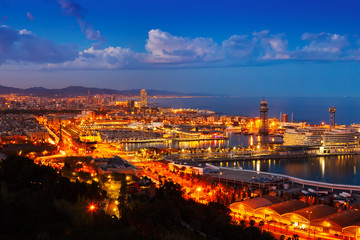 Port Vell and cityspace of Barcelona in evening