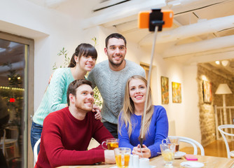 group of friends taking selfie with smartphone