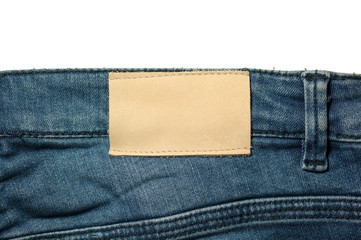 White leather label on jeans isolated on white