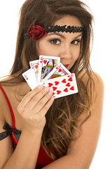 flapper girl with cards in hand close showing them