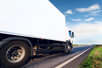 White truck on the asphalt road