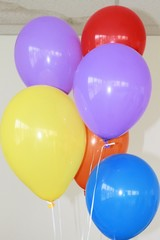 colorful balloons filled with helium