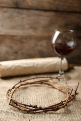 Crown of thorns, scroll and glass of wine