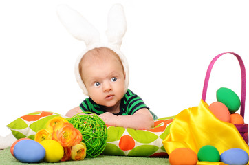 baby with easter colored eggs