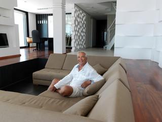 Portrait of senior man relaxing in sofa