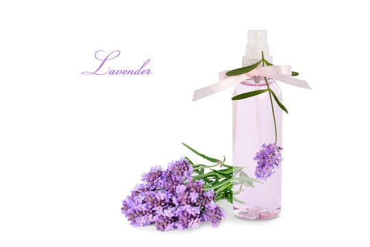 Lavender product in spray bottle and flowers isolated