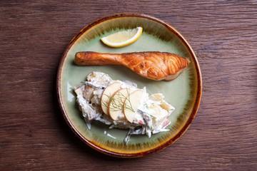 salmon steak with fruit salad