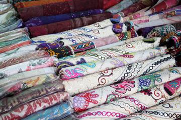 Folded pile of handmade textiles