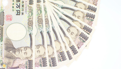 japanese currency yen or Japanese banknotes on white background