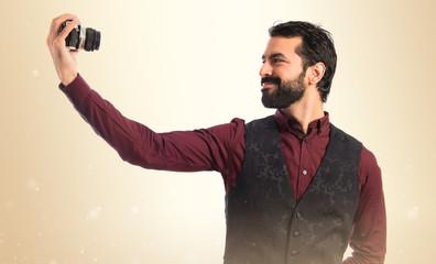 Man wearing waistcoat making a selfie