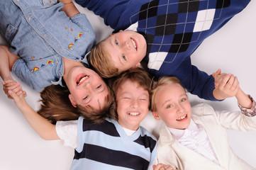 children lying on the floor
