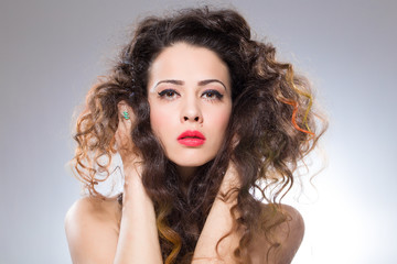Pretty girl with curved hair and red lipstick