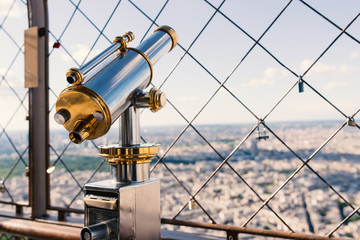 Binoculars at the top of Eiffel Tower in Paris, France. Filtered