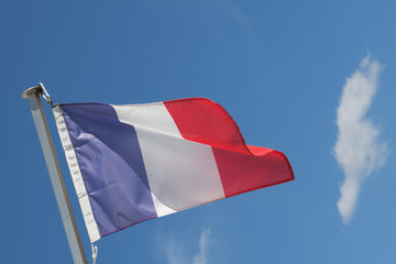 The french flag over a blue sky