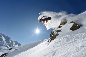 """Snowboarder pulls off a """"Method Air"""" in the backcountry Wall mural"""
