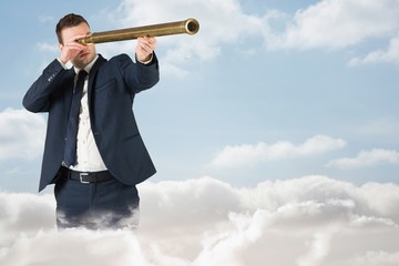 Composite image of businessman looking through telescope