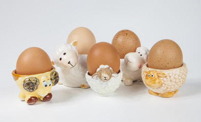 Set  of sheep (herd) shaped egg cups with boiled egg