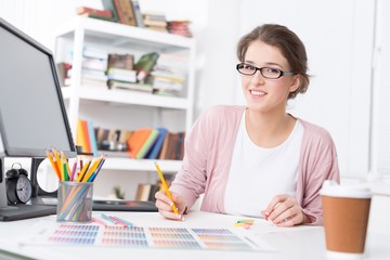 Designer. Portrait of a young graphic designer sketching at home