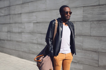 Wall Mural - Street fashion concept - stylish handsome african man