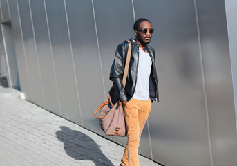 Wall Mural - Street fashion concept - handsome stylish young african man