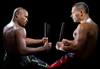 two men sparring with Filipino stick fighting martial arts