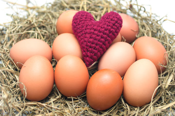 pink Heart Yarns on eggs in the nest. Heart health