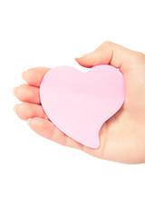 a cardboard heart is in a hand