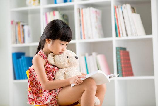Reading to teddy bear