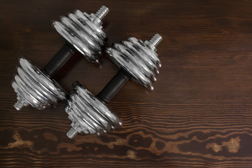 dumbbells on wooden table