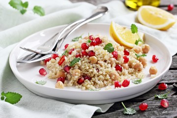 Quinoa salad with chickpea and pomegranate.Healthy eating.