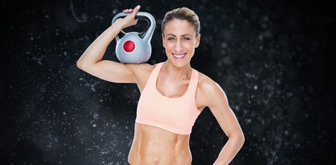 Female blonde crossfitter holding kettlebell