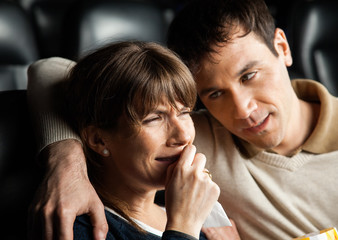 Man Comforting Woman Crying While Watching Movie