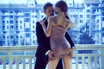Horizontal picture of high society loving couple. Guy with cigar