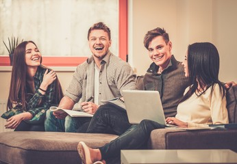 Group of students preparing for exams in apartment interior