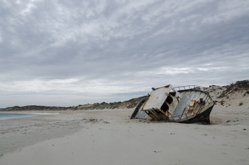 fishing boat wrecking on the beach fishing boat wrecking on the