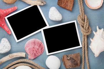 Blank photo frames with seashells, ship rope, sea stones