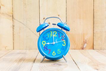 Alarm Clock in blue, showing nine o'clock