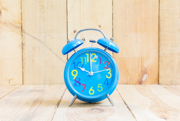 Alarm Clock isolated on white, in blue, showing ten o'clock