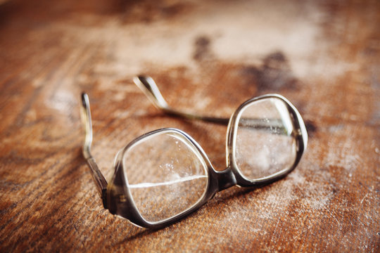 old glasses on wooden surface