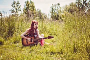 Girl plays the guitar