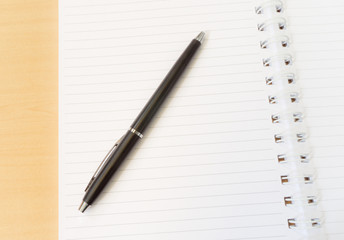 Two Pages Open Notebook with Black Pen on Wooden Surface with Id