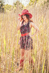 Romantic beautiful woman with straw hat
