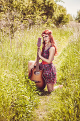 Romantic girl travelling with her guitar, summer, retro style